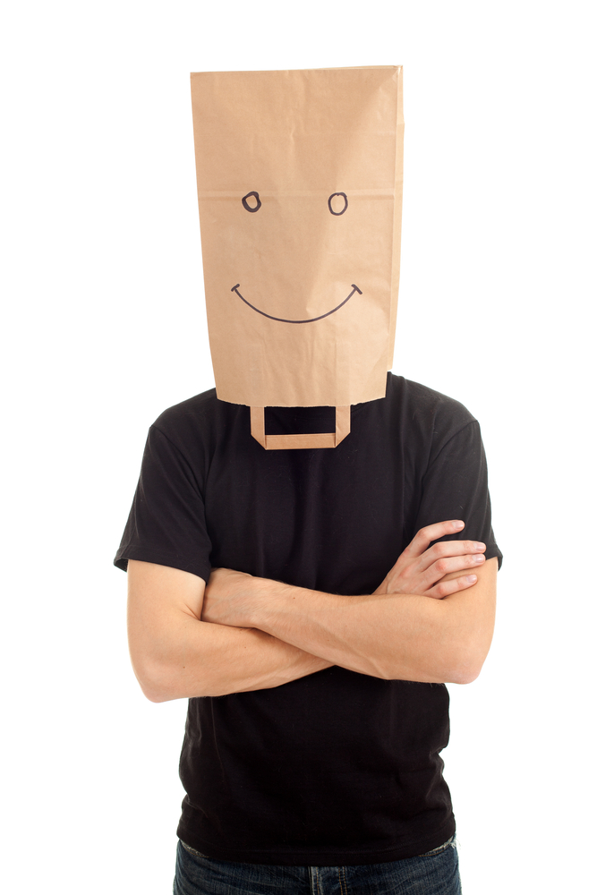 mystery man with paper bag on head